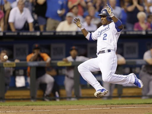 Kansas City Royals' Alcides Escobar slides home to score on a double hit by Alex Gordon during the second inning of a baseball game against the Detroit Tigers Tuesday, Aug. 28, 2012, in Kansas City, Mo. (AP Photo/Charlie Riedel)