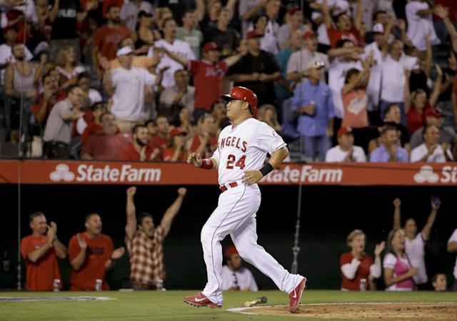 Los Angeles Angels' Hank Conger scores on double by Mike Trout during the fourth inning of a baseball game against the Los Angeles Angels in Anaheim, Calif., Tuesday, Aug. 26, 2014. (AP Photo/Chris Carlson)
