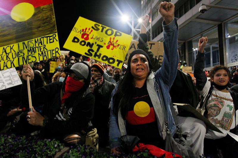 Protestors chant and bend down on their knees in Martin Place during a 'Black Lives Matter' rally on June 02, 2020 in Sydney, Australia. (Photo: Lisa Maree Williams via Getty Images)