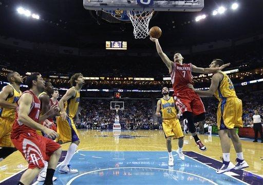 Houston Rockets guard Jeremy Lin (7) drives to the basket against New Orleans Hornets forward Ryan Anderson (33) in the first half of an NBA basketball game in New Orleans, Friday, Jan. 25, 2013. (AP Photo/Gerald Herbert)