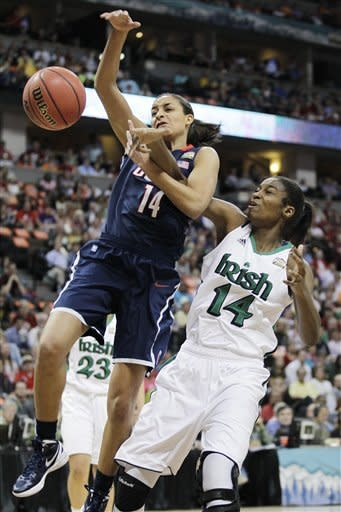 Connecticut guard Bria Hartley (14) and Notre Dame forward Devereaux Peters (14) vie for a rebound during the first half of the NCAA women's Final Four semifinal college basketball game in Denver, Sunday, April 1, 2012. (AP Photo/Julie Jacobson)
