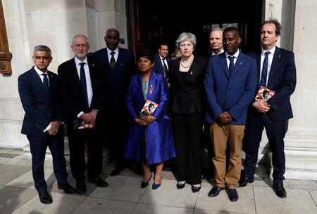 Britain's Prime Minister Theresa May, Sadiq Khan, the Mayor of London, and Jeremy Corbyn the leader of the Labour Party stand with Doreen Lawrence and her son Stuart, and Neville Lawrence as they leave a service at St Martin-in-The Fields to mark 25 years since her son Stephen Lawrence was killed in a racially motivated attack, in London, Britain, April 23, 2018. REUTERS/Peter Nicholls