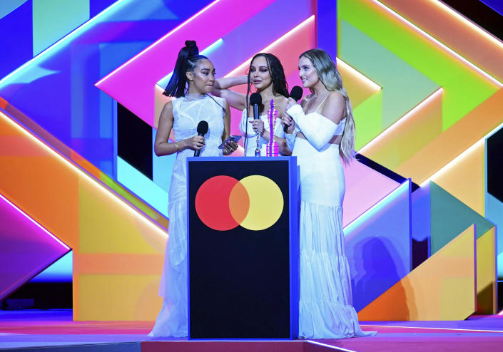 Little Mix accept the award for Best British Group during the Brit Awards 2021 at the O2 Arena, London, Tuesday, May 11, 2021. (Ian West/PA via AP)