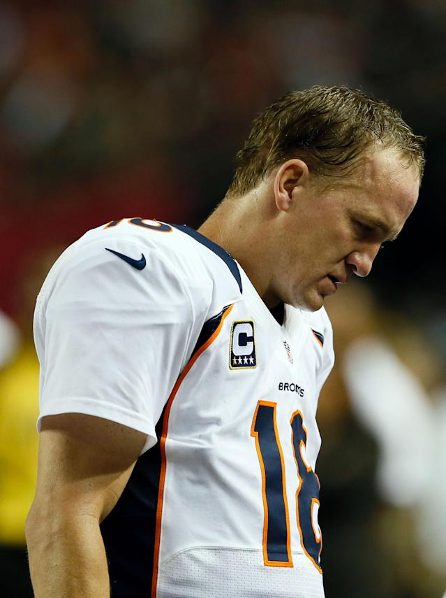ATLANTA, GA - SEPTEMBER 17: Quarterback Peyton Manning #18 of the Denver Broncos looks on after a play against the Atlanta Falcons during a game at the Georgia Dome on September 17, 2012 in Atlanta, Georgia. (Photo by Kevin C. Cox/Getty Images)
