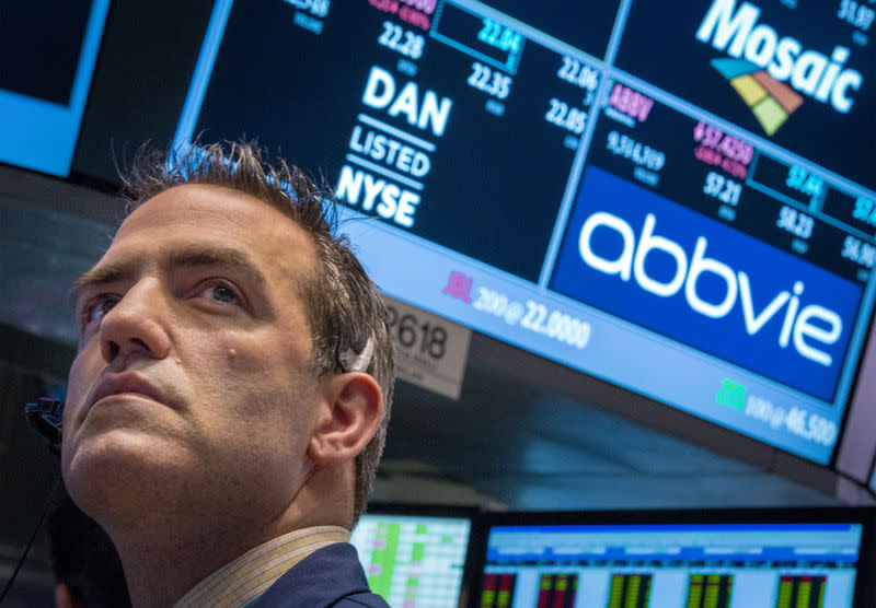 A trader works by the post that trades AbbVie on the floor of the New York Stock Exchange