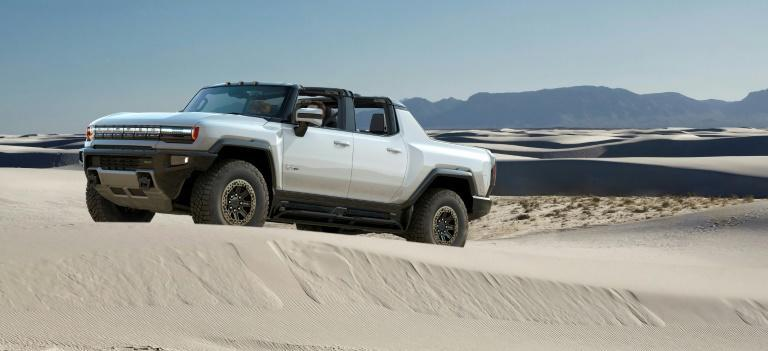 """The 2022 Hummer EV, featured at the virtual Consumer Electronics Show, includes off-road capbilities including a diagonal """"crab walk"""" feature and has """"a crazy amount of power,"""" according to General Motors"""