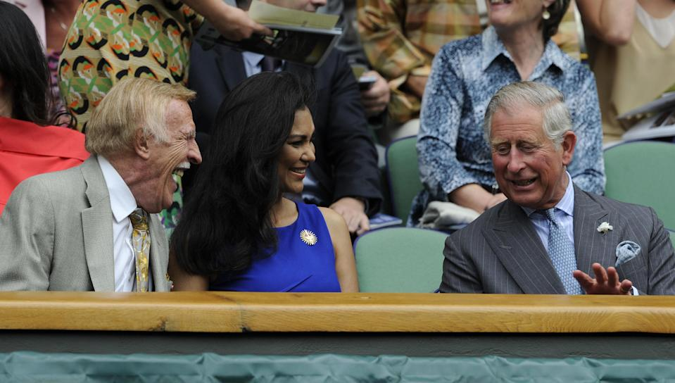 To see you nice! Prince Charles speaks to the late Sir Bruce Forsyth and his wife Wilnelia in the Royal Box during the 2012 Wimbledon Championships. (PA Images)