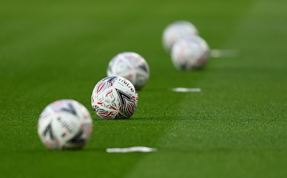 MANCHESTER, ENGLAND - JANUARY 24: A general view of the Official FA Cup match ball ahead of The Emirates FA Cup Fourth Round match between Manchester United and Liverpool at Old Trafford on January 24, 2021 in Manchester, England. Sporting stadiums around the UK remain under strict restrictions due to the Coronavirus Pandemic as Government social distancing laws prohibit fans inside venues resulting in games being played behind closed doors. (Photo by Michael Regan - The FA/The FA via Getty Images)