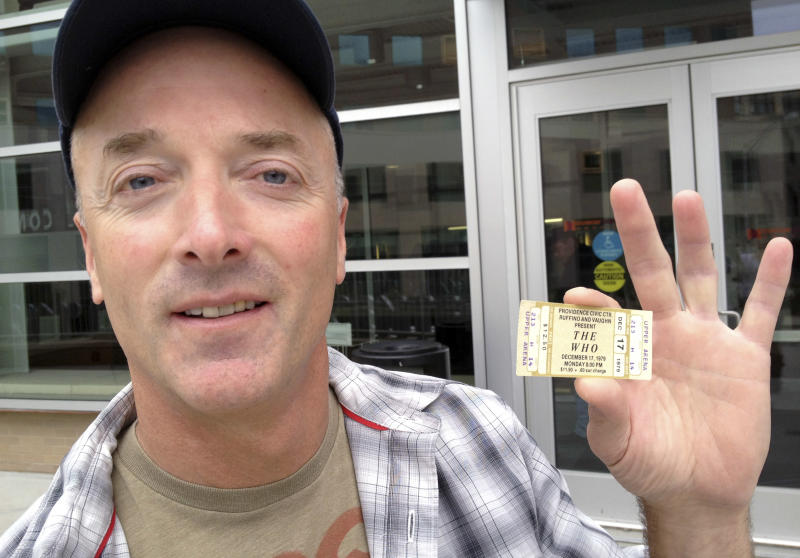 Emery Lucier, 50, of Milford, Mass., holds a ticket for a canceled1979 concert by The Who outside the Dunkin Donuts Center in Providence, R.I., Tuesday, July 31, 2012. Lucier was among fans who redeemed tickets from a canceled 1979 show, for The Who's Quadrophenia show set to play there in February 2013. Their 1979 concert was cancelled due to safety concerns after 11 people died in a stampede before a show in Ohio. (AP Photo/Michelle R. Smith)