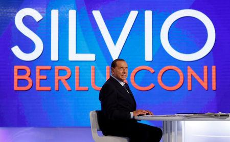 """Italy's former Prime Minister Silvio Berlusconi is seen during the television talk show """"L'aria che tira"""" in Rome"""
