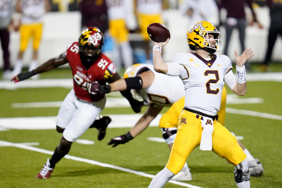 Minnesota quarterback Tanner Morgan attempts a pass against Maryland during the first half of an NCAA college football game, Friday, Oct. 30, 2020, in College Park, Md. (AP Photo/Julio Cortez)