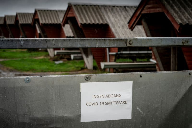 "A sign in Danish warns ""No access. Risk of infecting COVID-19"" at a mink farm in Hjoerring in North Jutland"