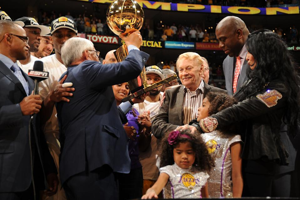 Los Angeles Lakers owner Dr. Jerry Buss receives the Larry O'Brien trophy after his team's victory over the Boston Celtics in Game Seven of the 2010 NBA Finals on June 17, 2010 at Staples Center in Los Angeles, California. (Photo by Andrew D. Bernstein/NBAE via Getty Images)
