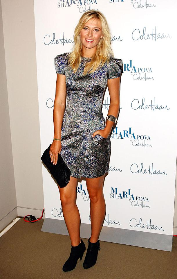 """Maria Sharapova scored an ace with the Elie Saab geometric print dress she wore to unveil her new Cole Haan line of footwear and handbags in NYC's Rockefeller Center. Too bad she paired it with ankle boots. Can't wait for that trend to die! Andrew H. Walker/<a href=""""http://www.gettyimages.com/"""" target=""""new"""">GettyImages.com</a> - August 27, 2009"""