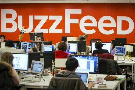 Buzzfeed employees work at the company's headquarters in New York January 9, 2014. BuzzFeed has come a long way from cat lists. REUTERS/Brendan McDermid