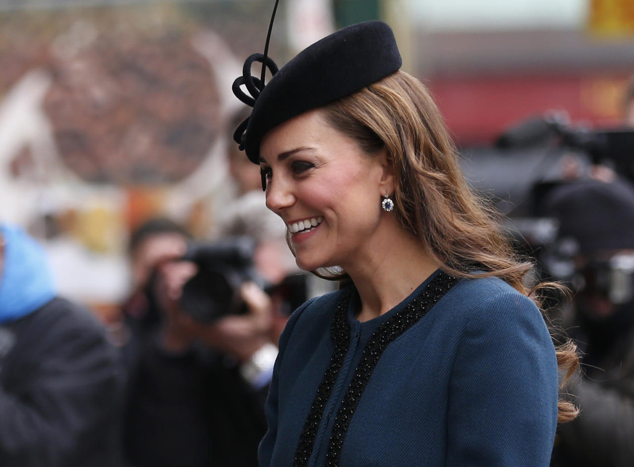Britain's Kate, Duchess of Cambridge, accompanies Queen Elizabeth II and Prince Philip, not pictured, arrives at Baker Street underground station in London for a visit to mark the 150th anniversary of the London Underground, Wednesday, March 20, 2013. (AP Photo/Sang Tan)