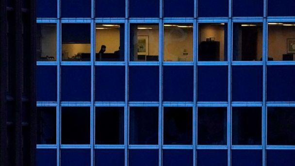 PHOTO: In this Jan. 26, 2021, file photo, employees work in an office building in midtown Manhattan in New York. (Timothy A. Clary/AFP via Getty Images, FILE)