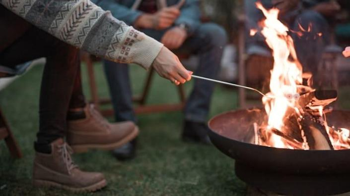 A fire pit is a safe way to bring the traditional campfire to your backyard.