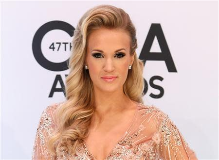Carrie Underwood poses on arrival at the 47th Country Music Association Awards in Nashville, Tennessee in this November 6, 2013, file photo. REUTERS/Eric Henderson/Files