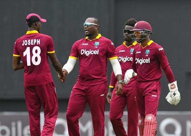 West Indies teammates celebrate the dismissal of Babar Azam of Pakistan caught by Alzarri Joseph (L) during the 1st ODI match between West Indies and Pakistan (AFP Photo/Randy BROOKS)