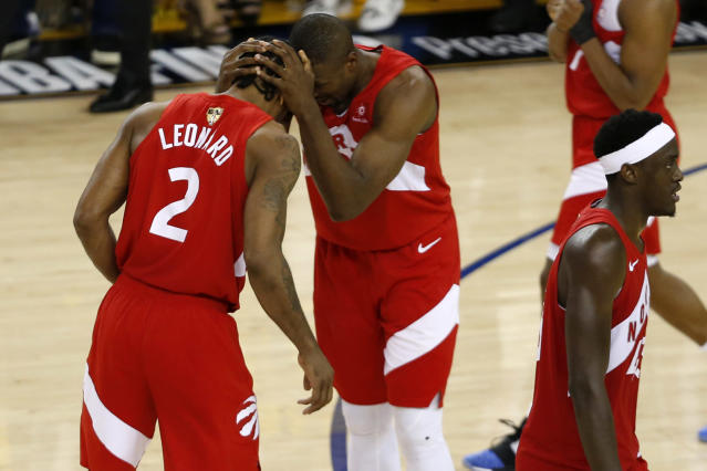 Kawhi Leonard #2 and Serge Ibaka #9 of the Toronto Raptors celebrate late in the game against the Golden State Warriors during Game Six of the 2019 NBA Finals at ORACLE Arena on June 13, 2019 in Oakland, California. (Photo by Lachlan Cunningham/Getty Images)