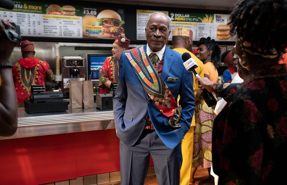 Cleo McDowell (John Amos) has his McDowell's branching out from Queens to Zamunda. (It's definitely not McDonald's.)
