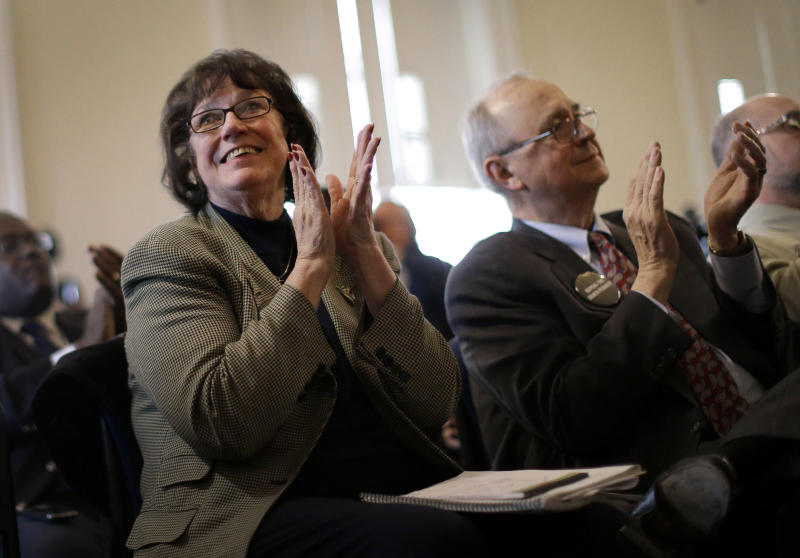 Anti-death penalty advocates Vicki Schieber, left, and her husband, Sylvester, react as Maryland Gov. Martin O'Malley, not pictured, speaks at a news conference in Annapolis, Md., Friday, March 15, 2013, after the Maryland General Assembly approved a measure to ban capital punishment. The Schiebers have been working to repeal the capital punishment in Maryland since their daughter, Shannon, was raped and murdered. The bill now goes to O'Malley, who is expected to sign it. Maryland would become the 18th state to abolish the death penalty. (AP Photo/Patrick Semansky)