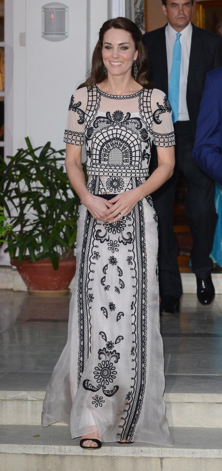 <p>While on a royal tour, Kate attended a garden party for the Queen's 90th birthday in India. Her outfit may look like an embroidered gown but it is in fact a crop top and maxi skirt by British label Temperley London. A simple black Prada clutch accessorised. </p><p><i>[Photo: PA]</i></p>