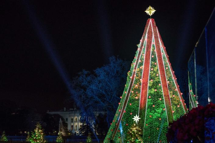 The National Christmas Tree is lit following a ceremony at the Ellipse near the White House in Washington on Wednesday. (Photo: Andrew Harnik/AP)