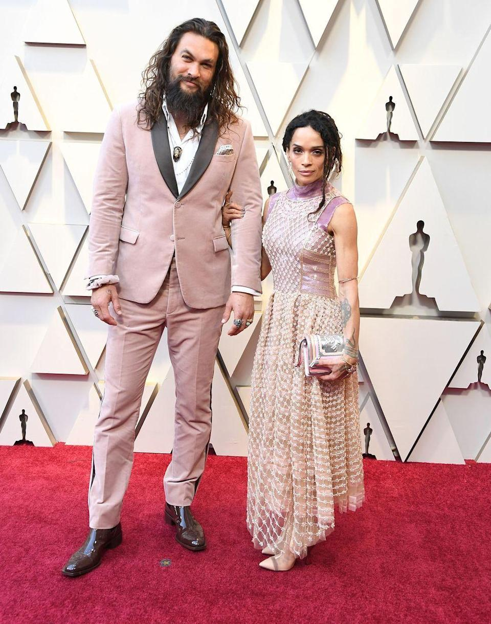 <p>A pink velvet Fendi tux—paying homage to Karl Lagerfeld, who passed away shortly before the 2019 Oscars—is a flex. Adding a pink velvet Fendi scrunchie to match? That's truly impressive.</p>