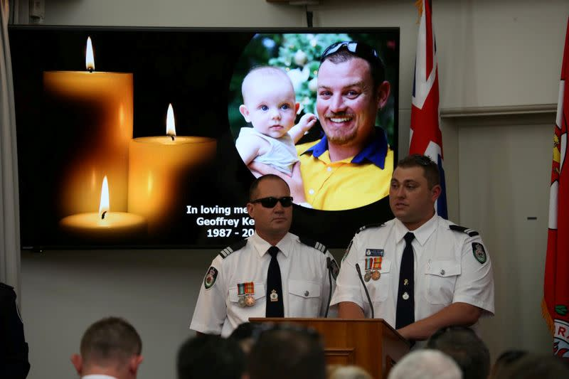 An image of late RFS volunteer Keaton is projected during his funeral in Buxton