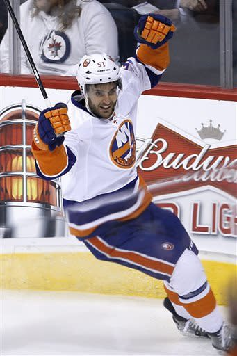New York Islanders' Frans Nielsen (51) celebrates his goal against Winnipeg Jets goaltender Ondrej Pavelec during the first period of an NHL hockey game in Winnipeg, Manitoba, Saturday, April 20, 2013. (AP Photo/The Canadian Press, John Woods)