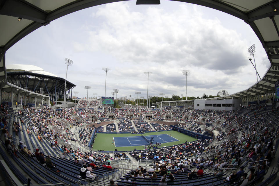 FILE - In this Aug. 28, 2017, file photo, spectators watch a match between Johanna Konta, of Great Britain, and Aleksandra Krunic, of Serbia, during the first round of the U.S. Open tennis tournament in New York. Spectators will not be required to wear masks or show proof of their vaccination status to attend matches at the U.S. Open when the tennis tournament returns at full capacity next week, one year after all fans were banned from the event because of the coronavirus pandemic. (AP Photo/Frank Franklin II, File)