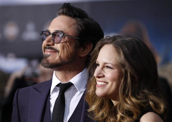 "Robert Downey Jr. and his wife Susan Downey pose at the world premiere of the film ""Marvel's The Avengers"" in Hollywood, April 11, 2012."