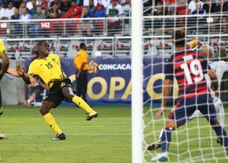 Jul 26, 2017; Santa Clara, CA, USA; Jamaica defender Je-Vaughn Watson scores a goal in the second half against the United States in the CONCACAF Gold Cup final at Levi's Stadium. Mandatory Credit: Mark J. Rebilas-USA TODAY Sports