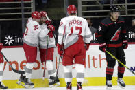 Detroit Red Wings' Filip Zadina (11) celebrates his goal with Adam Erne (73) and Filip Hronek (17) during the second period of an NHL hockey game against the Carolina Hurricanes in Raleigh, N.C., on Thursday, March 4, 2021. Hurricanes' Vincent Trocheck (16) skates away. (AP Photo/Chris Seward)