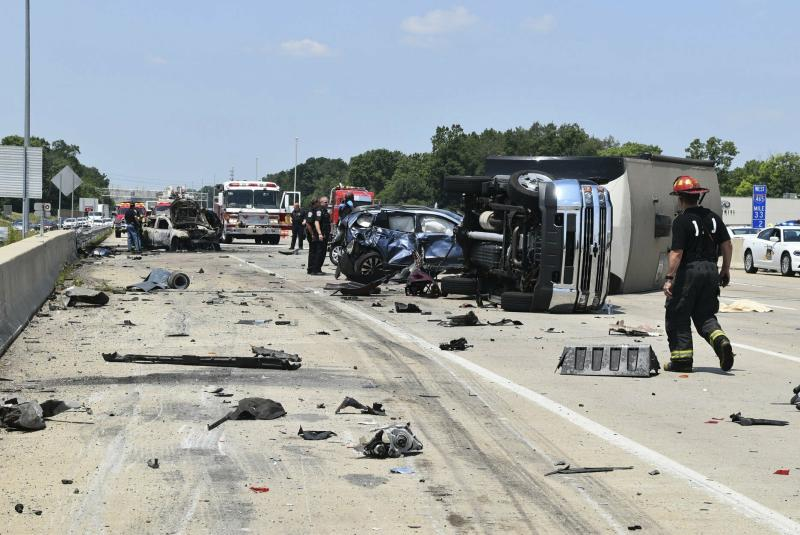 In this image taken Sunday, July 14, 2019, and provided by the Indianapolis Fire Department, emergency personnel work at the scene of fatal crash along Interstate 465 in Indianapolis. Authorities say a woman and her 18-month-old twin daughters died in the fiery, seven-vehicle crash on an Indianapolis freeway. (Battalion Chief Rita L. Reith/Indianapolis Fire Department via AP)