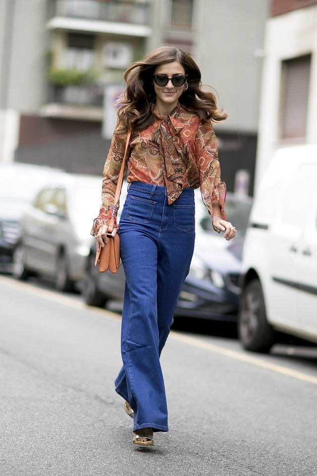 """Channel '70s vibes by picking a <a rel=""""nofollow"""" href=""""http://stylecaster.com/pussy-bow-blouse-trend-fall-2015/"""">pussy-bow blouse</a> with wide-leg jeans."""