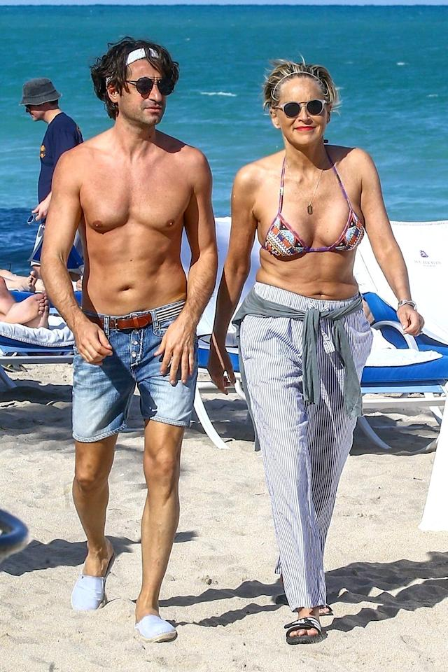<p>Stone and boyfriend Angelo Boffa braved the Miami heat for some fun in the sun. And before you even ask, she's 60! (Photo: VAEM/Backgrid) </p>
