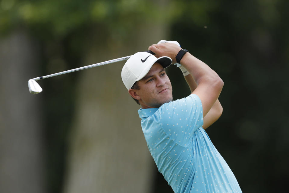 Cameron Champ drives from the 11th tee during the first round of the Rocket Mortgage Classic golf tournament, Thursday, July 2, 2020, at the Detroit Golf Club in Detroit. Champ was cleared to join the field under a modified PGA Tour policy that allows players who test positive for the coronavirus to be eligible if they had no symptoms and get two negative test results at least 24 hours apart. (AP Photo/Carlos Osorio)