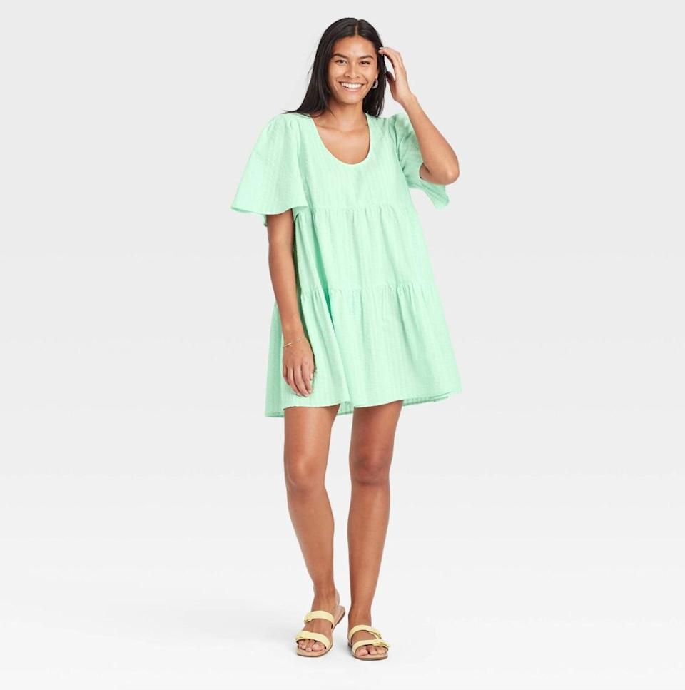 <p>I can't help but also love the <span>A New Day Flutter Short Sleeve Tiered Dress in Green</span> ($25). The almost-neon shade is subtle, yet bold.</p>