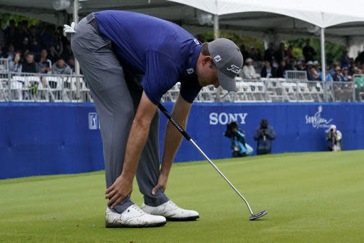 Webb Simpson reacts to missing his birdie putt on the 18th green during the final round of the Sony Open PGA Tour golf event, Sunday, Jan. 12, 2020, at Waialae Country Club in Honolulu. (AP Photo/Matt York)