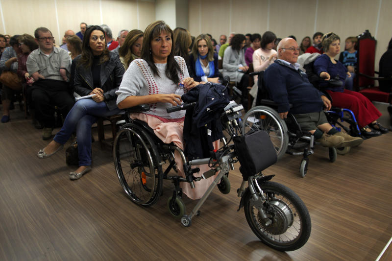 Spaniards born with severe defects wait for the trial against German company Gruenenthal Group to start at the Court in Madrid, Spain, Monday, Oct. 14, 2013. Spaniards born with severe defects after their mothers used the drug Thalidomide during their pregnancies are suing its producer, the German company Gruenenthal Group. The Monday trial will last one day and a ruling is expected within a month. Many of the children of the mothers who took the drug, a sedative prescribed between 1950 and 1960 to combat morning sickness, were born with abnormally short limbs and in some cases without any arms, legs or hips. Gruenenthal, who withdrew Thalidomide in 1961, has refused to accept liability, but last year it apologised to victims. (AP Photo/Andres Kudacki)