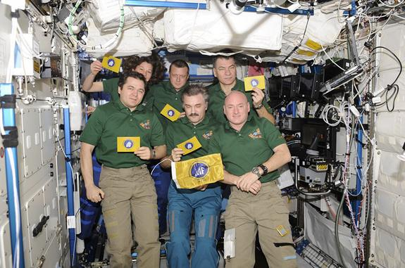 International Astronautical Federation (IAF) flags seen aboard the International Space Station during their first spaceflight with the Soyuz TMA-20 and Expedition 26 crews.