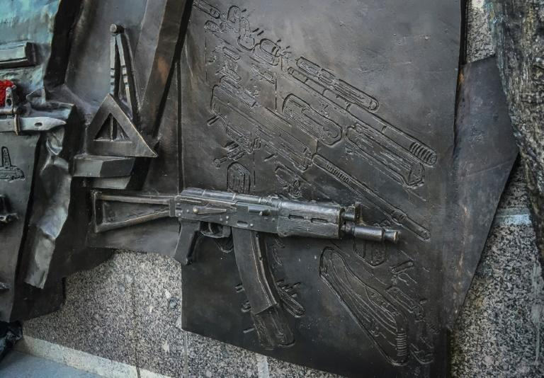 A view of a sketch allegedly featuring German StG44 rifle on the newly unveiled monument to Mikhail Kalashnikov, the inventor of the AK-47 assault rifle, in downtown Moscow on September 22, 2017