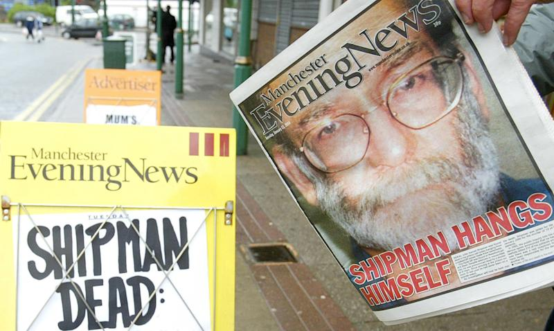 A Manchester Evening News board stands near the former surgery of Dr Harold Shipman, in Hyde, Manchester, on the day that the GP hung himself in his cell at Wakefield prison. Shipman was found at 6.20am and, despite the efforts of staff who immediately attempted resuscitation, he was pronounced dead by a doctor at 8.10am, a Prison Service spokeswoman said. (Photo by Martin Rickett - PA Images/PA Images via Getty Images)
