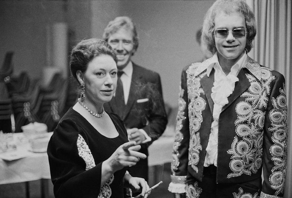 <p>Princess Margaret and her husband, Lord Snowdon, join Elton John backstage at a benefit concert in London in 1972. </p>