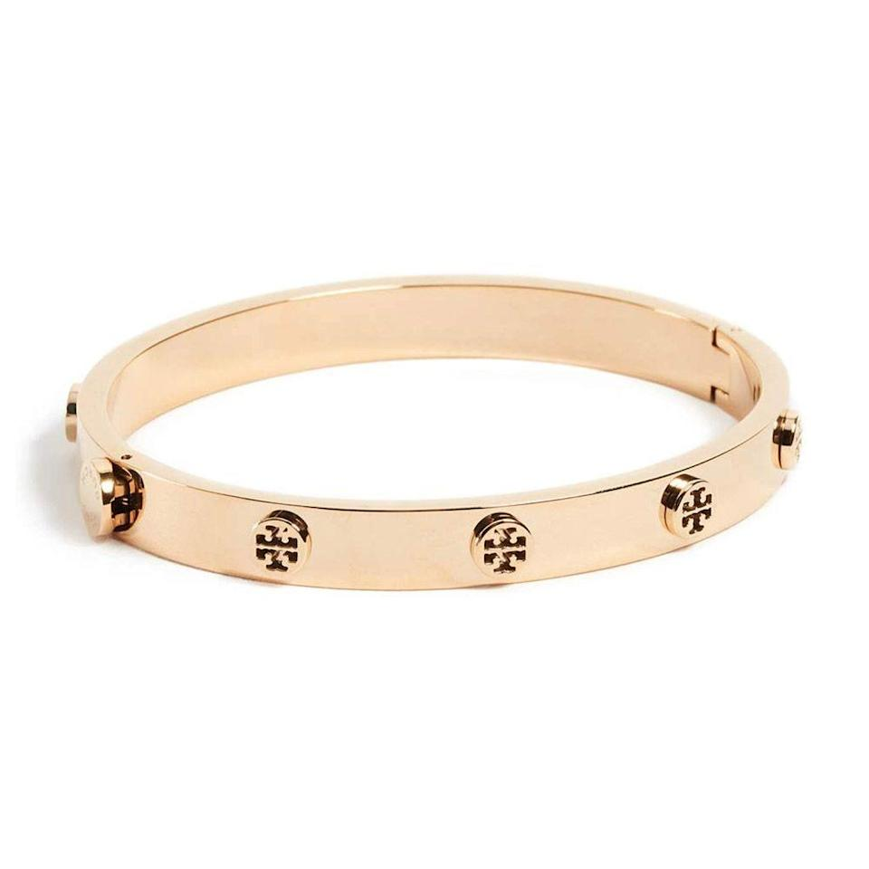 """<p><strong>Tory Burch</strong></p><p>amazon.com</p><p><strong>$219.04</strong></p><p><a href=""""https://www.amazon.com/dp/B01N5NG57S?tag=syn-yahoo-20&ascsubtag=%5Bartid%7C2089.g.3395%5Bsrc%7Cyahoo-us"""" rel=""""nofollow noopener"""" target=""""_blank"""" data-ylk=""""slk:Shop Now"""" class=""""link rapid-noclick-resp"""">Shop Now</a></p><p>Taking its design cues from the classic Cartier bangle, this Tory Burch option is a lot more affordable. It's a sleek, perfect everyday bracelet that you can dress up or down.</p>"""