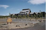"<p>You might not expect to find a hotel within the confines of <span class=""redactor-unlink"">Yellowstone National Park</span>, but this rustic, log cabin–style resort has been in business here since 1904. It's considered to be the largest log structure in the world, consisting of 327 rooms, a stone fireplace, and a full-service restaurant for visitors to enjoy while they're taking in the natural sights.<br></p><p><strong>EXPLORE NOW:</strong> <a href=""https://www.tripadvisor.com/Hotel_Review-g60999-d220121-Reviews-Old_Faithful_Inn-Yellowstone_National_Park_Wyoming.html"" rel=""nofollow noopener"" target=""_blank"" data-ylk=""slk:Old Faithful Inn"" class=""link rapid-noclick-resp"">Old Faithful Inn</a></p>"