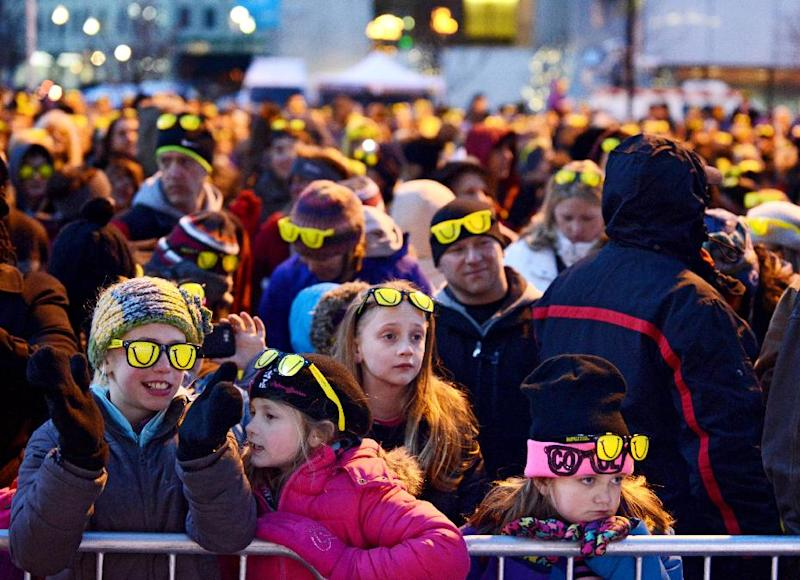 Crowds brave the cold to break the current Guinness World Record for people wearing sunglasses in the dark for the fourth annual Laughfest Kickoff at Rosa Parks Circle in downtown Grand Rapids, Mich., on Thursday, March 6, 2014. The current record was set at Wrigley Field in Chicago in July 2012 with 1,642 people. (AP Photo/MLive.com, Emily Rose Bennett)